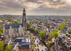 Amsterdam aerial view of Westerkerk church seen from north on Koningsdag Kings day festivities. Birthday of the king. Seen from helicopter.