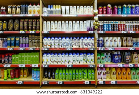 Amsterdam, April 2017. Display in a shop with a large collection of shampoo and conditioner  #631349222