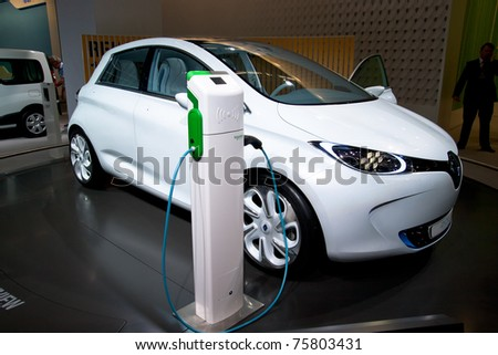 AMSTERDAM - APRIL 22 - Electric Renault Zoe concept car next to a charger pole, on display at the AutoRAI motorshow. April 22, 2011 in Amsterdam, The Netherlands.