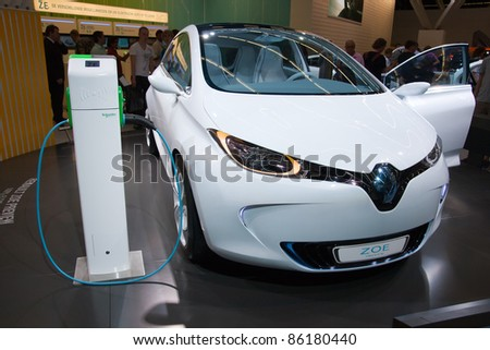 AMSTERDAM - APRIL 22: Electric Renault Zoe concept car next to a charger pole, on display at the AutoRAI motorshow. April 22, 2011 in Amsterdam, The Netherlands.