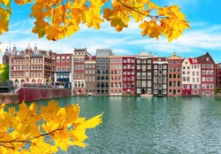 Amsterdam architecture at Damrak canal in autumn, Netherlands