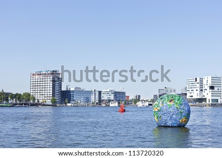 AMSTERDAM-AUG. 19, 2012. Floating globe on Aug. 19, 2012 in Amsterdam. Artist Peter Singer has attracted a lot of publicity with his creation World of Litter floating globe of plastic waste.