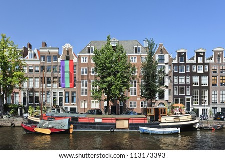 AMSTERDAM-AUG. 19, 2012. Houseboat on Aug. 19, 2012 in Amsterdam. There are around 2,500 house boats along 165 canals where locals live. The canal belt was added to world heritage list in July 2010