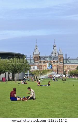 AMSTERDAM-AUG. 17, 2012. Museum square on Aug. 17, 2012 in Amsterdam. Several museums are located around the very touristy square: Rijksmuseum, Van Gogh Museum, Stedelijk Museum and Diamond Museum.