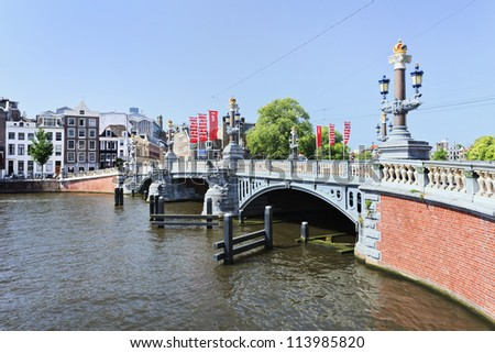 AMSTERDAM-AUG. 19, 2012. Ornate ancient bridge on Aug. 19, 2012 in Amsterdam. It is known as Venice of the North, its beautiful canal belt was finally added to world heritage list in July 2010.