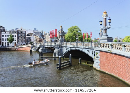AMSTERDAM-AUG. 19: Ornate ancient bridge on Aug. 19, 2012 in Amsterdam. It is known as Venice of the North, its beautiful canal belt was finally added to world heritage list in July 2010.