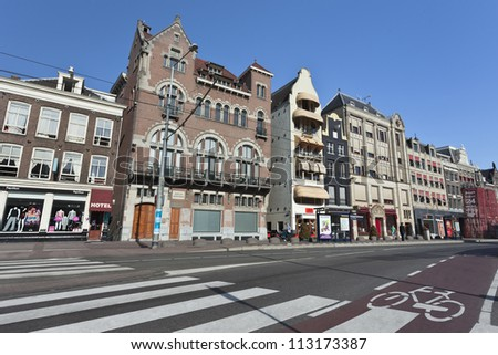 """AMSTERDAM-AUG. 19, 2012. Rokin on Aug. 19, 2012 in Amsterdam. It is a major street in Amsterdam,  originally a part of the river Amstel, and was known then as Ruck-in, which means """"??to withdraw""""??. - stock photo"""