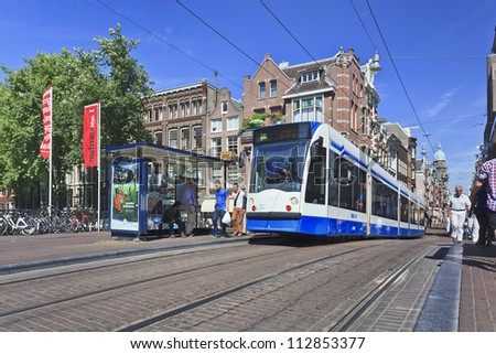 AMSTERDAM-AUG. 18, 2012. Tram on Aug. 18, 2012 in Amsterdam. Transport in the city exist mainly by bicycle and public transport. Amsterdam has 16 different tram lines with a total length of 213 km.