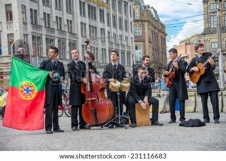 AMSTERDAM, AUGUST 4: large group of street performers improvise a live concert in the DAM square on August 4, 2014 in Amsterdam