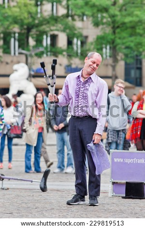 AMSTERDAM-AUGUST 26, 2014. Superfrank the street performer. Amsterdam offers every summer plenty low-cost entertainment, special performances, festivals, cultural events and street performers.