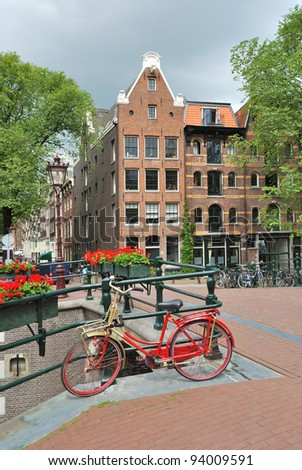 Amsterdam. Beautiful  bridge decorated with flowers over  the canal Brouwersgracht
