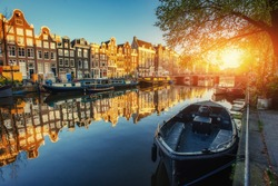 Amsterdam canal at sunset. Amsterdam is the capital and most populous city in Netherlands.