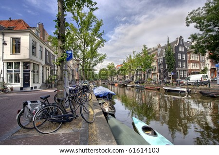 Amsterdam canal with bicycles and small boats