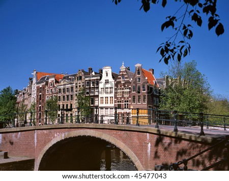 Amsterdam canals and typical Dutch houses on a  sunny day. No people