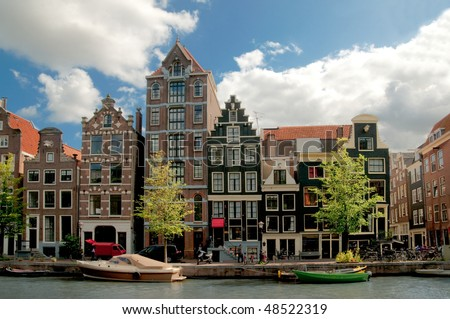 Amsterdam canals and typical houses with clear spring sky