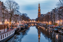 Amsterdam canals in the evening light, Dutch canals in Amsterdam Holland Netherlands during winter time in the Netherlands. Europe