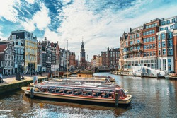 Amsterdam city in spring. Empty city in quarantine due to outbreak of infection of Coronavirus Covid-19. Famous Dutch channels and great cityscape, Netherlands, Europe.