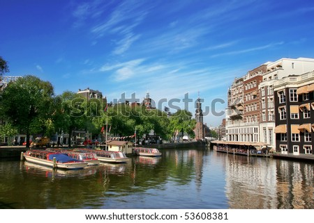 Amsterdam cityscape and Amstel river in Netherlands.