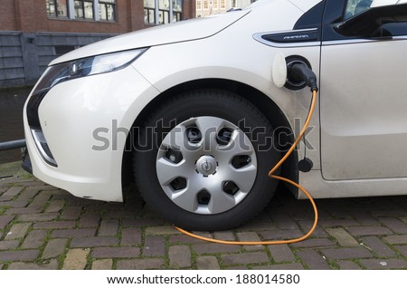 AMSTERDAM - FEBRUARY 23, 2014: Charging an electric car at a charging station in Amsterdam. In 2015 there will be 2000 charging stations in the city