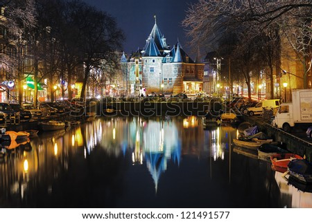 AMSTERDAM - FEBRUARY 15: Evening view of The Waag (old city gate) on February 15, 2011 in Amsterdam, Netherlands. The Waag of 15th century is the oldest remaining non-religious building in the city.