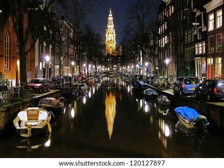 AMSTERDAM - FEBRUARY 15: Evening view on Zuiderkerk from Groenburgwal channel on February 15, 2011 in Amsterdam, Netherlands. The Zuiderkerk was the city's first church built for Protestant services. - stock photo