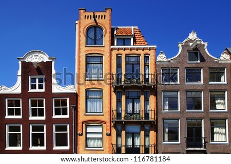 AMSTERDAM, HOLLAND - AUGUST 01: Dutch scenery traditional houses. Typical merchant houses  buildings with a facade composed of three windows; August 01, 2012 Amsterdam, Holland