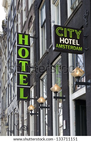AMSTERDAM - JANUARY 6: Hotel sign of the city hotel amsterdam on january 6, 2013 in Amsterdam. It is a two-star family hotel in an 18th century building located in the center of Amsterdam