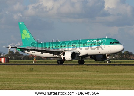AMSTERDAM - JULY 01: Aer Lingus Airbus A320 lands at AMS Airport in Netherlands on July 01, 2012. Aer Lingus is the national flag carrier of Ireland. It operates a fleet of only Airbus aircraft.
