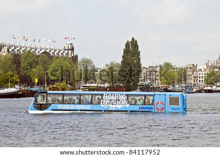 AMSTERDAM - JULY 16: New way to attract tourism to Amsterdam: Floating bus is cruising through Amsterdam canals, july 16, 2011 in Amsterdam the Netherlands