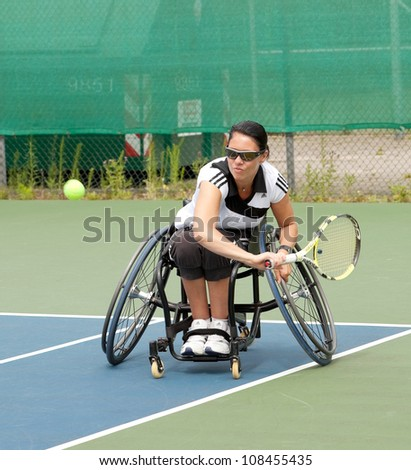 AMSTERDAM - JULY 21: Unidentified athlete participates in Amsterdam Open Wheelchair Tennis competition, held on July 21, 2012 in Amsterdam,The Netherlands