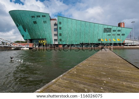 AMSTERDAM - JUNE 5: The Nemo Museum, the largest science center in the Netherlands on June 5, 2006 in Amsterdam. With over 500,000 visitors annually, it is the country's fourth most visited museum. - stock photo