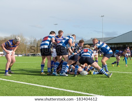 AMSTERDAM - MAR 22: Ball on the ground after a maul formation during The Hague (blue-orange) vs Hilversum rugby match on March 22, 2014, in Amsterdam, The Netherlands