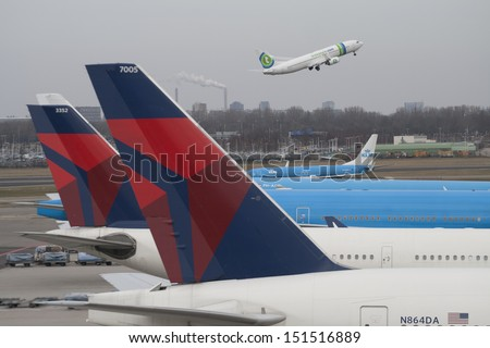 AMSTERDAM, MARCH 3 : KLM and Delta airlines planes at Schiphol Airport march 3, 2013 in Amsterdam,The Netherlands.