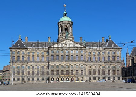 AMSTERDAM - MAY 27: Royal Palace at the Dam Square on May 27, 2013 in Amsterdam, Netherlands. The palace in holland classicism style was built as a city hall during the Dutch Golden Age in 1648-1655.