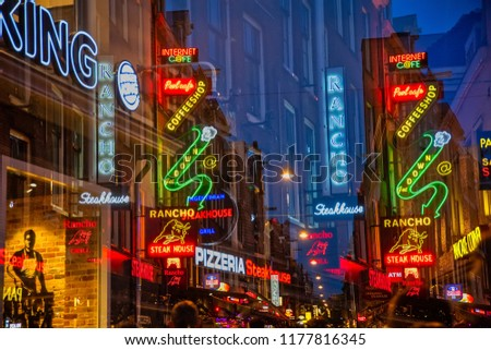 Amsterdam, Netherland - July 7, 2018:Colorful night lights with music entertainment and bars in walking street Korte Leidsedwarsstraat at Amsterdam in a multiple exposure. is a busy tourist street.