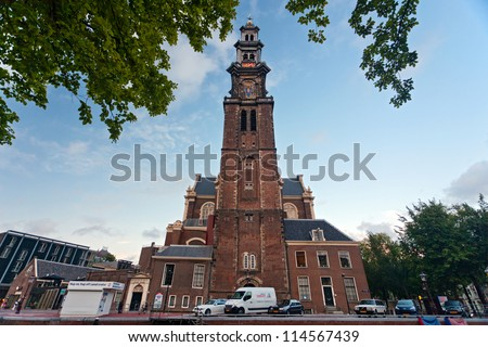 "AMSTERDAM, NETHERLANDS - AUG 6: Westerkerk (""western church"") located near Anne Frank house on August 6, 2012. The spire (Westertoren) is the highest church tower in Amsterdam"