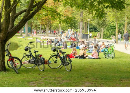 Amsterdam, Netherlands - August 5, 2014: Vondelpark favorite place for rest and walking residents and tourists. - Shutterstock ID 235953994