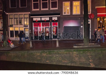 Amsterdam, Netherlands - December 14, 2017: The buildings of Amsterdam city