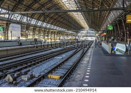 AMSTERDAM, NETHERLANDS - JUNE 18, 2014: Interior of Amsterdam Central Train Station (Amsterdam Centraal). Central Station is central railway station of Amsterdam, is used by 250,000 passengers a day.