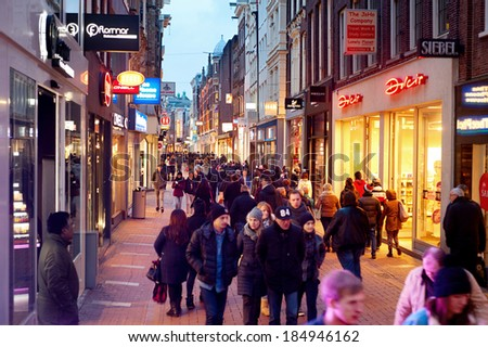 AMSTERDAM, NETHERLANDS - MARCH 01, 2014: Unidentified people walking on Kalverstraat - main shopping street of Amsterdam. The Kalverstraat is the most expensive shopping street in the Netherlands.