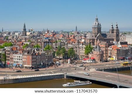 AMSTERDAM, NETHERLANDS - MAY 28: Historic buildings in the center on May 28, 2012 in Amsterdam. The country's largest city is visited with over 3,5 million foreign tourists a year.