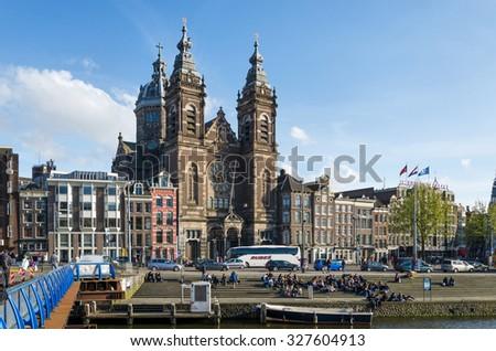 Amsterdam, Netherlands - May 8, 2015: Tourists at Church of Saint Nicholas(Basilica of Saint Nicholas) on May 8, 2015 in Amsterdam, Netherlands.The basilica has a collection of religious murals.