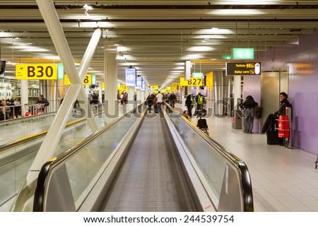 AMSTERDAM, NETHERLANDS - NOVEMBER 10: Photo of long horizontal escalator at Schiphol international airport terminal in Amsterdam, Netherlands on November 10, 2014.