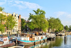 Amsterdam, Netherlands. Residential barges and houses on the water. Canal (street) Keizersgracht. The historic city center