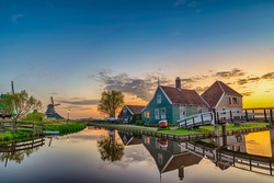 Amsterdam Netherlands, Sunrise landscape of Dutch Windmill and traditional house at Zaanse Schans Village