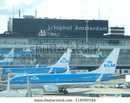 AMSTERDAM - OCTOBER 6: KLM plane being loaded at Schiphol Airport October 6, 2012 in Amsterdam, Netherlands. There are 163 destinations served by KLM, many are located in the Americas, Asia and Africa