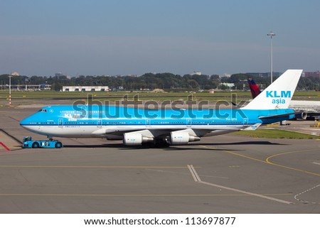 AMSTERDAM - SEP 9: KLM Royal Dutch Airlines Boeing 747-400 at Schiphol airport Sep 9, 2012, Amsterdam, Netherlands. KLM is the flag airline of the Netherlands. It operates worldwide. - stock photo