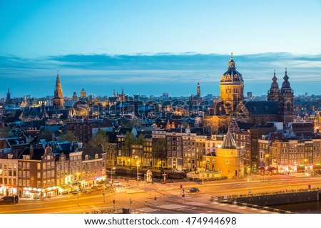 Amsterdam skyline in historical area at night, Amsterdam, Netherlands. Ariel view of Amsterdam, Netherlands. Landscape and nature travel, or historical building and sightseeing concept