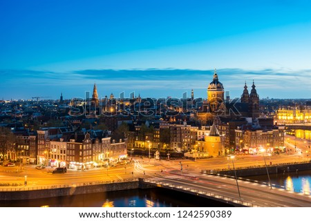 Amsterdam skyline in historical area at night, Netherlands. Ariel view of Amsterdam, Netherlands. Landscape and nature travel, or historical building and sightseeing concept