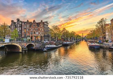 Amsterdam sunset city skyline at canal waterfront, Amsterdam, Netherlands Stockfoto ©